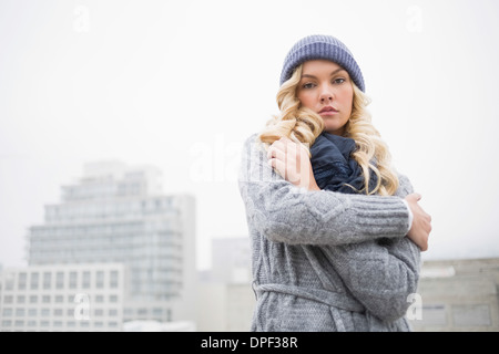 Cold gorgeous blonde posing outdoors - Stock Photo