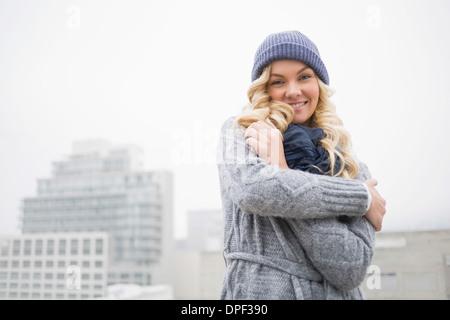 Smiling gorgeous blonde posing outdoors - Stock Photo