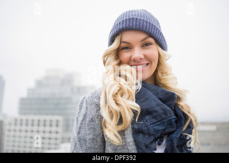 Happy gorgeous blonde posing outdoors - Stock Photo