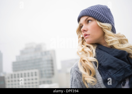 Thoughtful gorgeous blonde posing outdoors - Stock Photo