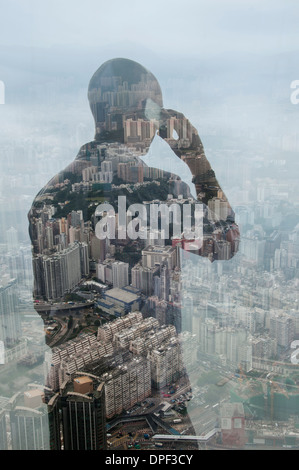 Businessman using smartphone and Hong Kong cityscape, composite image - Stock Photo