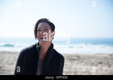 Mature woman on Newport Beach, California, USA - Stock Photo