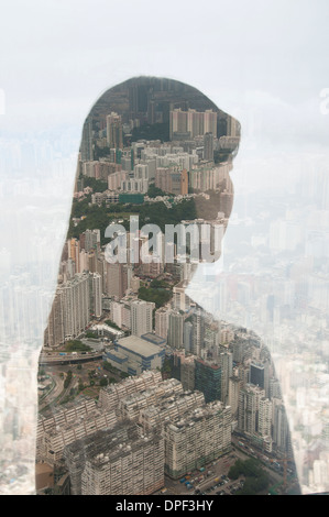 Businesswoman and Hong Kong cityscape, composite image - Stock Photo