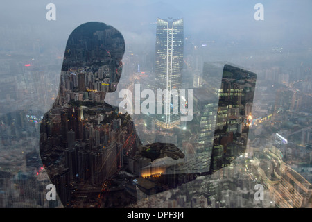 Businesswoman using laptop and Hong Kong cityscape, composite image - Stock Photo