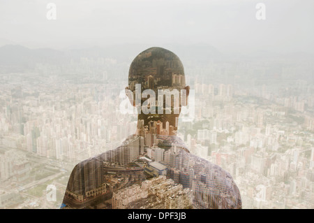 Businessman and Hong Kong cityscape, composite image - Stock Photo