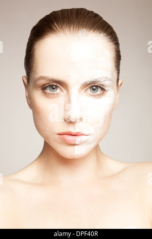 Model with powder on one side of face - Stock Photo