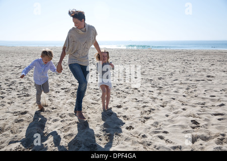 Mother holding hands with son and daughter, Newport Beach, California, USA - Stock Photo