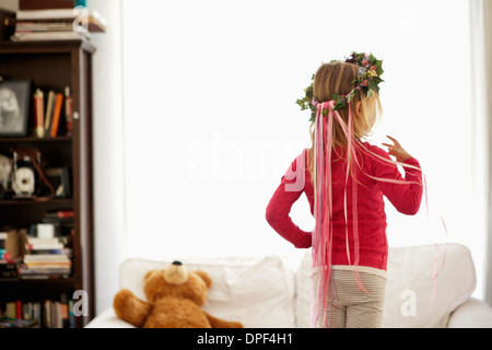 Young girl wearing ivy and ribbon headdress - Stock Photo