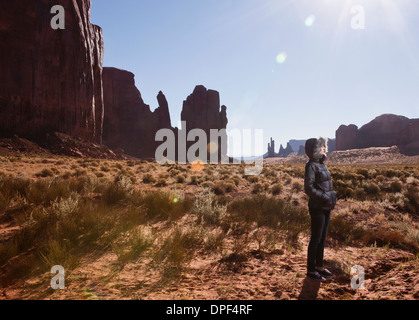 Female tourist alone in Monument Valley, Navajo Tribal Park, Arizona, USA - Stock Photo