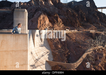 Senior woman looking out from Hoover Dam, Nevada, USA - Stock Photo
