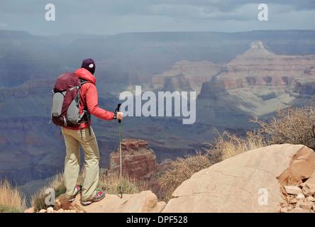 Female hiker viewing Grand Canyon, Flagstaff, Arizona, USA - Stock Photo