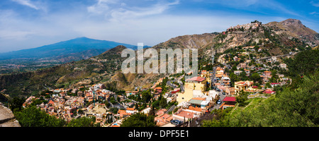 Taormina and Castelmola on the right, with Mount Etna in distance, Sicily, Italy, Europe - Stock Photo