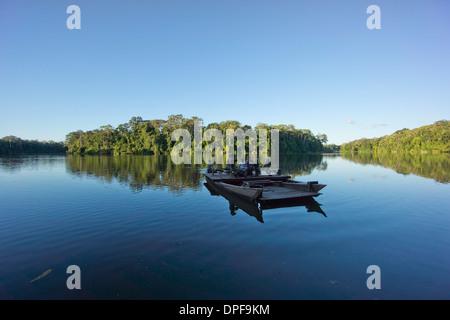 Tourist boat on Lake Salvador, Manu National Park, UNESCO World Heritage Site, Peru, South America - Stock Photo