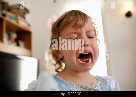 Close up of female toddler crying - Stock Photo