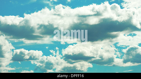 Flying the heavy clouds in the blue sky - Stock Photo