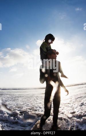 Father and daughter in sea, Encinitas, California, USA - Stock Photo