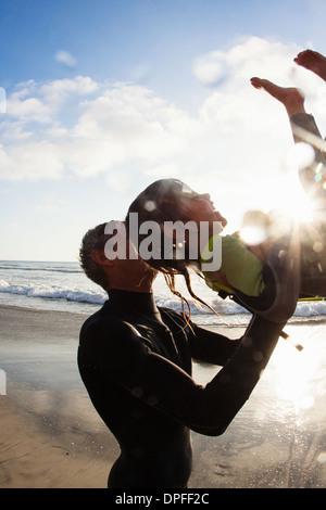 Father and daughter enjoying beach, Encinitas, California, USA - Stock Photo