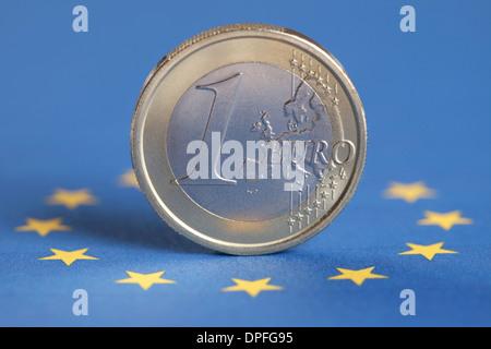 One Euro coin on the European Union flag - Stock Photo