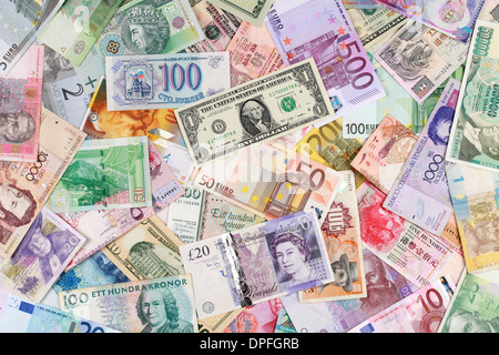 Currency from all over the world such as Euro, Dollar, Pound and Franc - Stock Photo