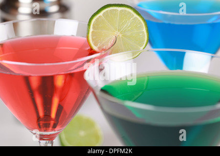 Colorful Cocktails such as Cosmopolitan, Blue Curacao and Martini in glasses - Stock Photo