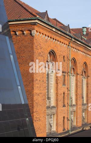 Corner of the Black Diamond Building, the modern extension to the Royal Danish Library, Copenhagen, Denmark - Stock Photo