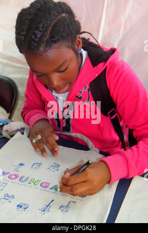 Miami Florida Book Fair International Miami Dade College event festival Black girl student coloring colouring drawing - Stock Photo