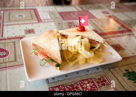 A Swiss Club Sandwich in a cafe, - Swiss food meal, Torgon, Valais, Switzerland , Europe - Stock Photo