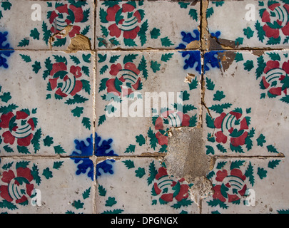 traditional patterned tiles decorate a wall in Lisbon - Stock Photo