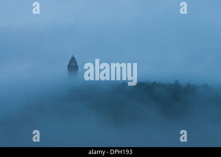 The Wallace Monument in Stirling, Scotland, UK on a misty winter afternoon. - Stock Photo
