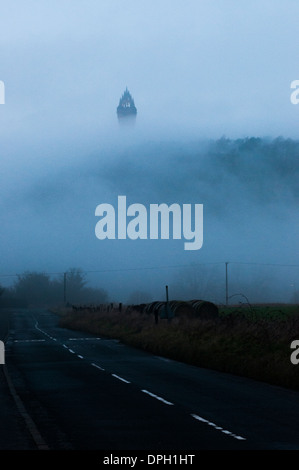 Wallace Monument in Stirling, Scotland, UK on a misty winter afternoon. - Stock Photo