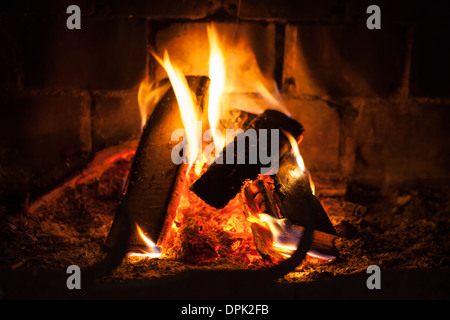 Natural photo background with fire in fireplace - Stock Photo