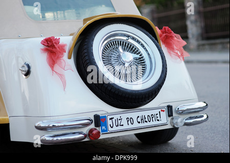 Classic car museum. Car prepared for carriage on a pair of young Polish wedding. - Stock Photo