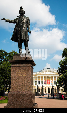 A monument to Alexander Pushkin on the Arts Square, with the Mikhailovsky Palace in the background, Saint Petersburg, - Stock Photo
