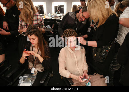 Berlin, Germany. 15th Jan, 2014. Models get themselves prepared backstage during the Autumn/Winter 2014 shows of - Stock Photo