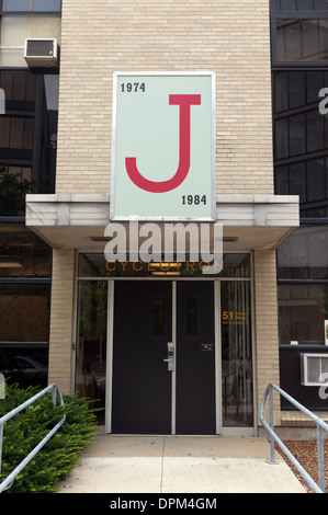 J-particle sign from Cyclotron building entrance, MIT building 44. - Stock Photo