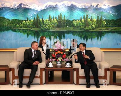 Beijing, China. 15th Jan, 2014. Chinese State Councilor Guo Shengkun (R), who is also minister of public security, - Stock Photo