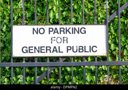No parking sign on iron gate - Stock Photo