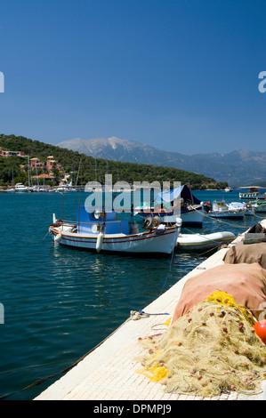 Fishing boats moored in Vathi harbour, Meganisi island, Lefkada, Ionian Islands, Greece. - Stock Photo
