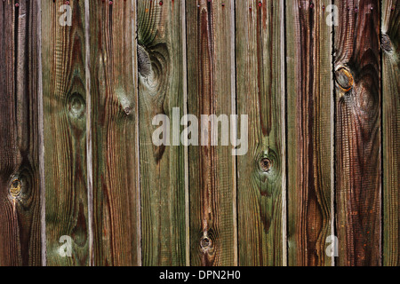 Old wooden fence with knots as background - Stock Photo