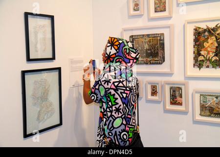 Miami Florida Midtown Miami Project Art Basel satellite fair gallery man woman smartphone taking picture fashion - Stock Photo