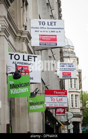 Row of commercial premises to let in a city centre in England. - Stock Photo