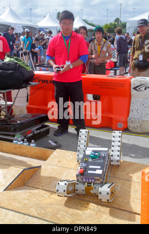 Miami Homestead Florida Speedway DARPA Robotics Challenge Trials exhibits student Asian man operating remote controlled - Stock Photo