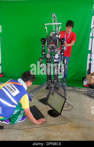 Miami Homestead Florida Speedway DARPA Robotics Challenge Trials remote controlled robot robots man student engineering - Stock Photo