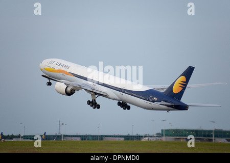 Jet Airways Boeing 777-300 climbing after taking off - Stock Photo