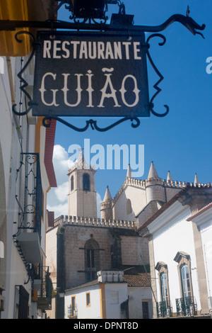 Évora Igreja de Sao Francisco Church of St Francis with restaurant sign in foreground street scene Alentejo Portugal - Stock Photo