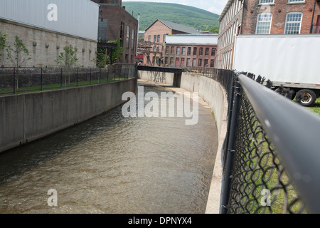 Flood chutes carry a branch of the Hoosic River through the Massachusetts Museum of Contemporary Art complex in - Stock Photo