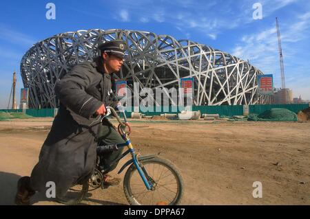 Dec. 7, 2006 - Dec 07, 2006, Beijing, A security member cycles at construction site of the National Stadium structure, - Stock Photo