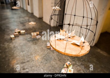 USHUAIA, Argentina - An art installation using paper, books, and a bird cage in the art gallery at the Maritime - Stock Photo