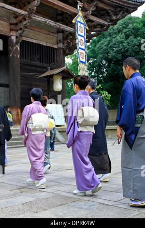 Japanese women wearing a traditional kimono and obi in a Buddhist procession at Todaiji Temple, Nara, Japan. - Stock Photo