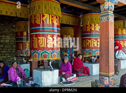 Pilgrims at the buddhist prayer whees at the Memorial Chorten or Thimphu Chorten,Thimphu, Bhutan - Stock Photo